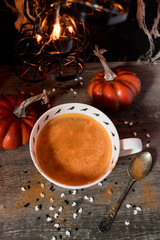 Seasonal fall pumpkin drink in Halloween setting top view
