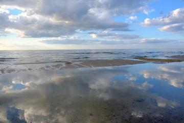 Cloud reflection on a beach