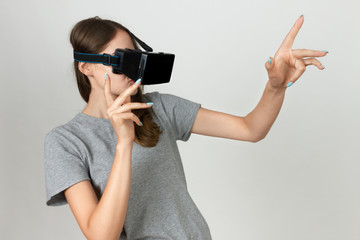 Girl in the helmet of virtual reality