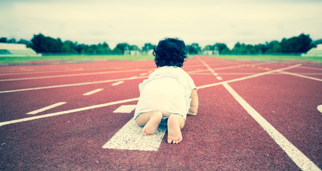 Baby start crawling on runner lane, Business learning to startup concept.