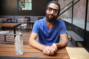Hipster in cafe