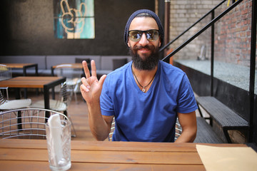 Hipster showing peace sign