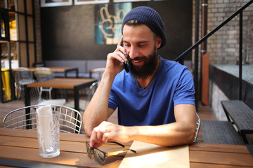 Guy talking on phone