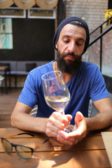 Bearded man with glass of wine
