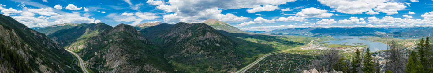 Panorama of mountains, winding highway, and Dillon, Colorado