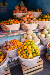 Tropical colorful fruit stand on the road in the remote village San Juan La Laguna in the highlands of  Guatemala.