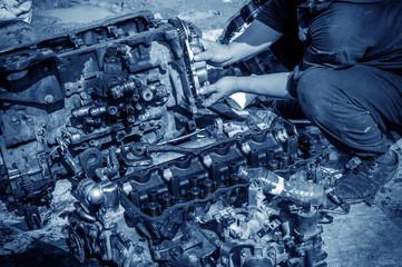 Workers repair diesel engines