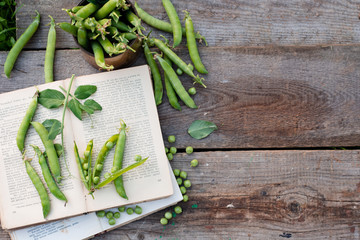 green peas on rustic wooden background