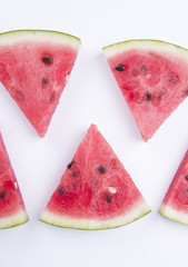 Top view of sliced watermelon on white background.