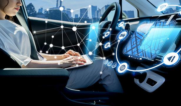 young woman riding autonomous car. self driving vehicle. driverless car.