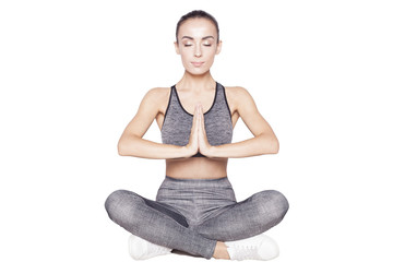Fitness Woman in lotus position isolated on white.