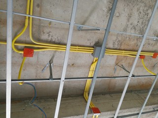 Install the ceiling frame and wiring pipe.