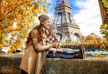 mother and child travelers in Paris pointing on something