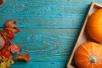 Wooden table with pumpkin, maple