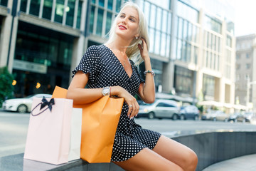 Girl with purchases in dress