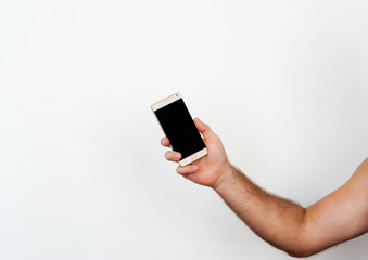 male hands hold the phone