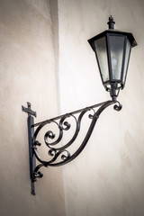 An ancient metal street lamp on the facade of the house in Istria, Croatia, Europe.