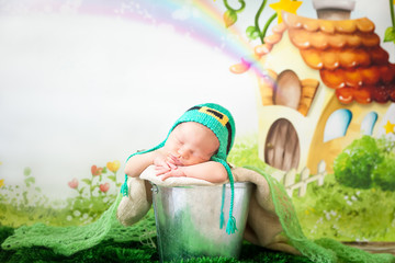 Sleeping newborn baby in a St. Patrick's Day hat
