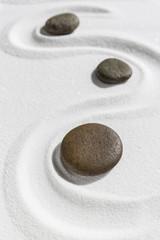 Foto op Plexiglas Stenen in het Zand Zen stone on white sand background