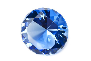 Blue gemstone isolated on white background with shadow. Clipping path included.