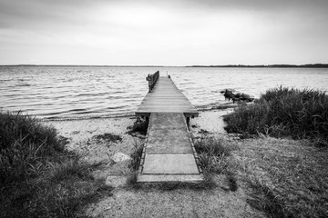 Black and white photo of a wooden pier