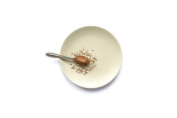 Spoonful of Cacao on White Background