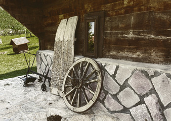 Old horse car wheel and plow