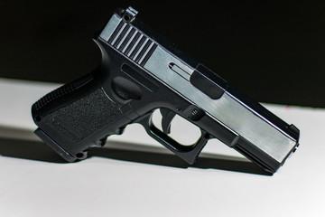 Handgun on a white table
