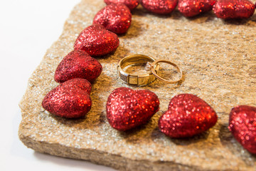 Wedding rings on a natural stone with inclusions of native gold. Offer hands and hearts.