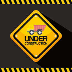 under construction road sign with truck vehicle