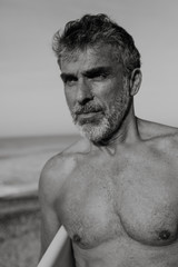Mature surfer man on the beach