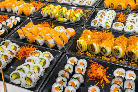 Great variety of sushi rolls at a buffet