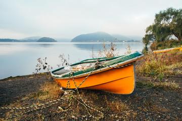 Orange Wooden Boat on Lake Shore