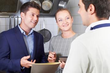 Meeting Of Restaurant Team In Kitchen