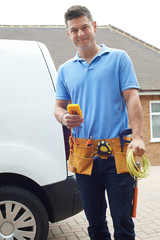 Portrait Of Electrician With Van Outside House