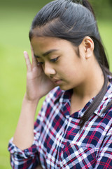 Outdoor Portrait Of Stressed Young Girl