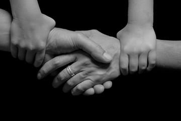 Children hands holding adult hands together