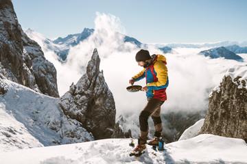 Portrait of male mountaineer having scrambled eggs for breakfast