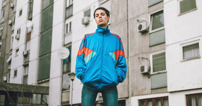 Young adolescents in colorful  track suits from 90's in east Europe projects.