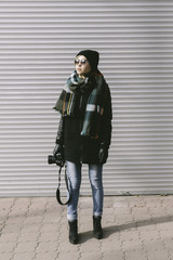 woman with film camera on the street