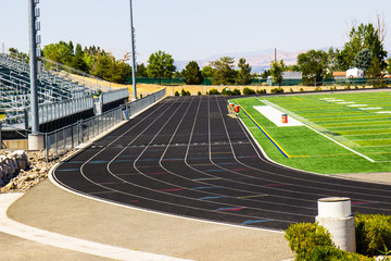 Running Track With Bleachers & Field