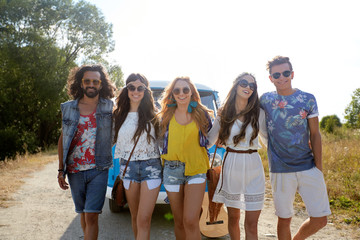 smiling happy young hippie friends and minivan car
