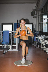Young woman doing exercises in a gym