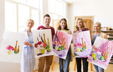 group of artists with pictures at art school