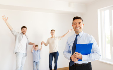 realtor with clipboard and family at new home