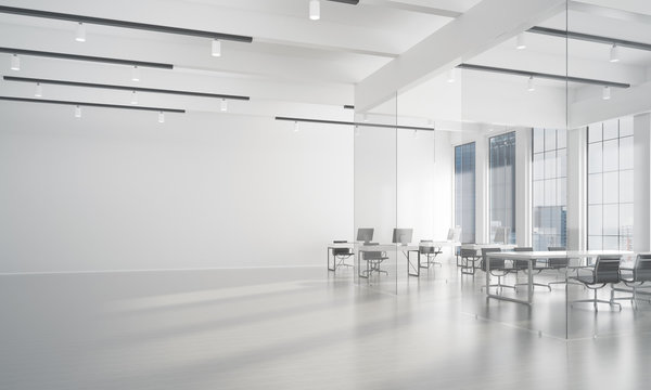 Office interior design in whire color and rays of light from window