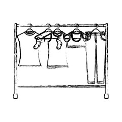 monochrome blurred silhouette of female clothes rack with t-shirts and pants on hangers