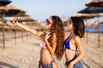 sexy girls having fun on a beach