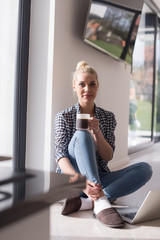 young woman drinking coffee enjoying relaxing lifestyle