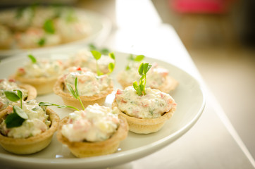 Tartlets with cream cheese salad. Catering services
